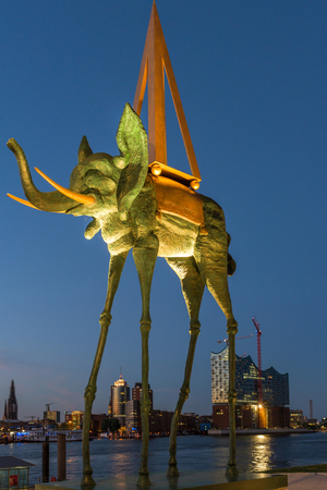The Salvador Dali monument Space Elephant in front of the Hamburg skyline with the HafenCity Editorial