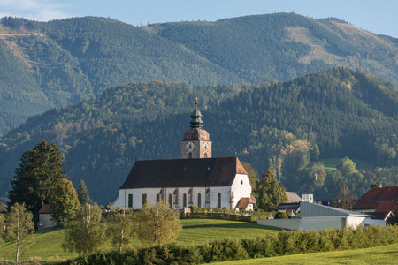 upper case: Church in the village Grossraming, a small town in the Ennstal Alps in Upper Austria. The national park Limestone Alps with the largest closed and virtually uninhabited forest area in Austria Editorial