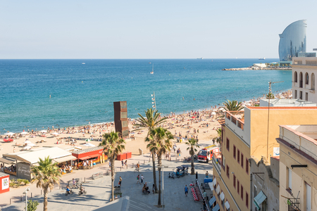 beachfront: Top view to the Barceloneta beach. The beach is very popular among young tourists, who visit Barcelona. The beach is in close to downtown and very famous