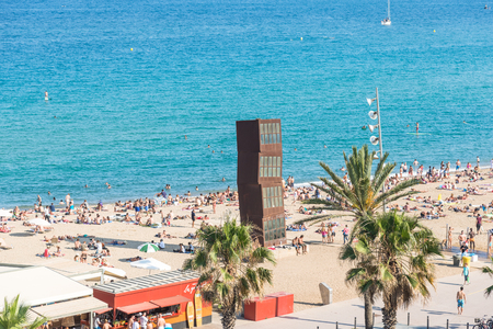 Top view to the Barceloneta beach. The beach is very popular among young tourists, who visit Barcelona. The beach is in close to downtown and very famous