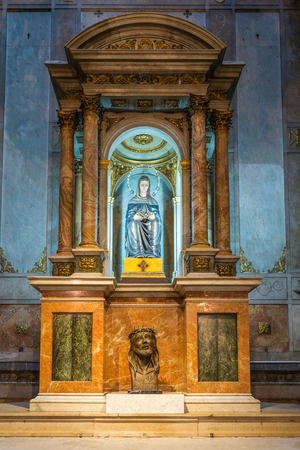 merce: Blue and gold colored saints statuette on a pedestal in the church Basilica of Our Lady of Mercy, BasÃlica de la Merce, Barcelona