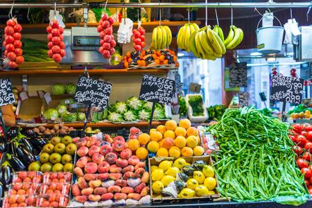 Greengrocer at the famous market Mercat de Sant Josep de la Boqueria Barcelona