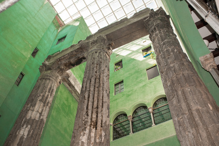 glorification: The remaining columns of the Roman Temple of Augustus in the backyard of a building in the barri Gotic district of Barcelona Stock Photo