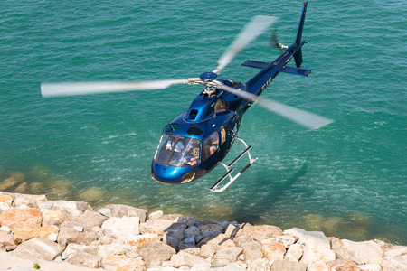 Helicopter landing in the harbor of Barcelona. The aircraft is back from a round trip over Barcelona