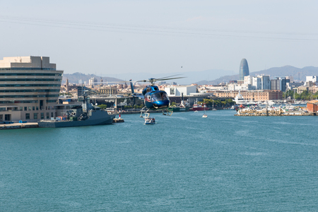 Helicopter above the harbor of Barcelona. The aircraft is on a round trip over Barcelona