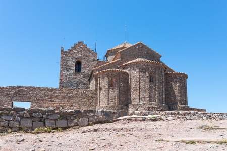 Monastery of Sant Llorenc del Muntis, on the top of La Mola, the summit of the rocky mountain massif. The original monastery was built in the mid-11th century is Catalan Romanesque style Stok Fotoğraf