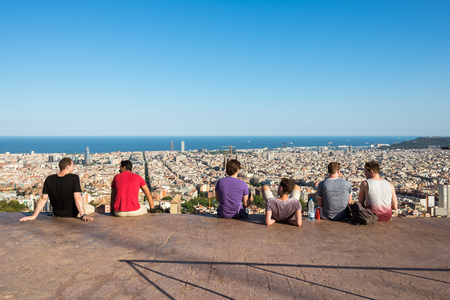 Young people watching the skyline of Barcelona Editorial