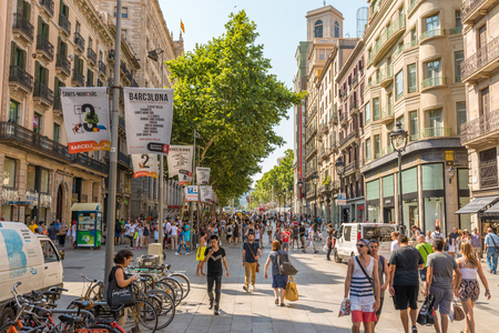 Tourists and residents of Barcelona in the pedestrian zone in the street Portal del Angel Editöryel