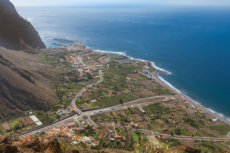 Above the headland of the Valle Gran Rey on the Canary Island of La Gomera. View to the small villages at the end of the canyon. Vueltas, La Puntilla, Borbalan. So the harbor, situated in Vueltas