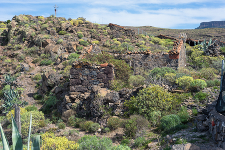 Collared stone shed in the hamlet Gerian on La Gomera, The small village is located on the top of the Barranco de Argaga on the canary archipelago, The trail is heavy to hike, with steep slopes Stock Photo - 95812712
