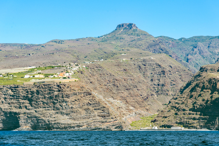 La Fortaleza on La Gomera. The mountain is a huge volcanic plug on the west side of the island. In the foreground the steep coast of the village La Dama