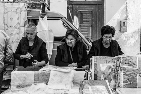 Three old ladies on the market in Tymbaki in the south-central of Crete Standard-Bild - 106465500