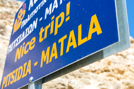 Town sign from Pitsidia and Matala on the road at the entrance to Matala. Both villages are one municipality.