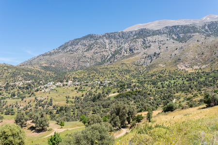 The village Kouroutes at the foot of the Ida mountain range on Crete Imagens - 99303592