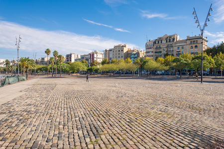 Pedestrian zone in the front of the Barceloneta district of Barcelona. The Plaza Muelle del Rellotge is part of Port Vell, the oldest part of the Port of Barcelona