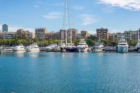 Luxury yachts are mooring at the marina Port Vell in Barcelona Editorial
