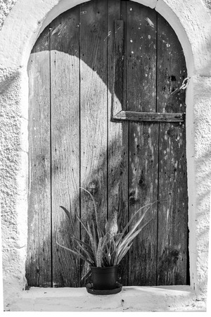 Monochrome picture from a wooden door in the village of Pitsidia in the south-central of Crete.