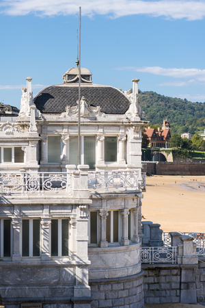 The Royal Bathhouse Real Casa de Banos at the La Concha bay and beach Donostia San Sebastian. In former times the bathhouse was used as part of the summer residence used by the Royal Spanish Family Standard-Bild - 116663236