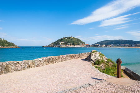 Donostia, San Sebastian. View to the mountain Urgull with the sculpture of Christ and the small island Santa Clara, Stock Photo