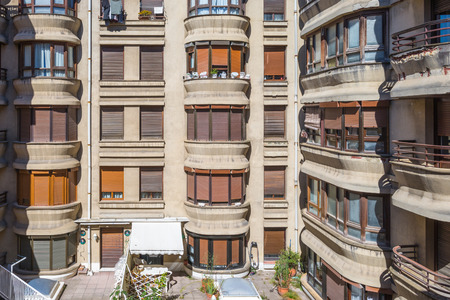 Rear view and backyard of a tenement building in the city of San Sebastian Donostia. A typical courtyard in the city center of the town Standard-Bild - 116663278