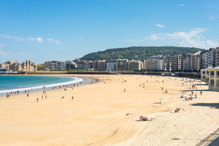 Walking on the beach at La Concha, a sand beach with shallow waters. It is one of the most famous urban beaches in Europe