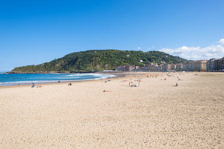 The beach at Zurriola in Donostia San Sebastian on October 02, 2016. The beach, located in the district Gros of Donostia is famous for surfing, sports and relaxing Stock Photo