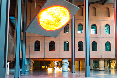Huge electronic display in the Azkuna Center, in Basque Azkuna centroa, shows the sun and gives information in the multi-purpose venue, located in the city of Bilbao, Spain Standard-Bild - 123224455