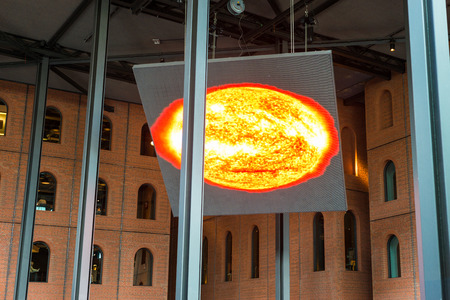 Huge electronic display in the Azkuna Center, in Basque Azkuna centroa, shows the sun and gives information in the multi-purpose venue, located in the city of Bilbao, Spain Standard-Bild - 123224508