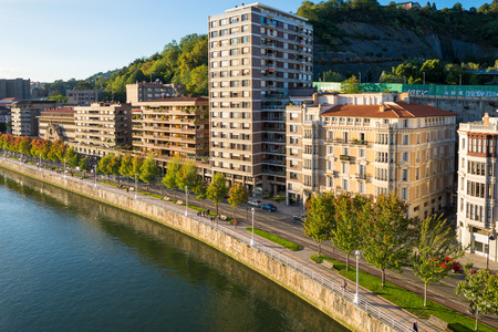 View from the famous bridge Salbeko Zubia, to the Deusto and Uribarri districts of Bilbao and the Nervion river that runs through the city into the Cantabrian Sea