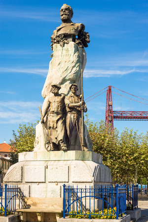 Monument to Don V?ctor Chavarri in his home town of Portugal at the Plaza del Solar. Chavarri is founder of the province of Biscay, in the Basque country. In the back the Vizcaya Bridge