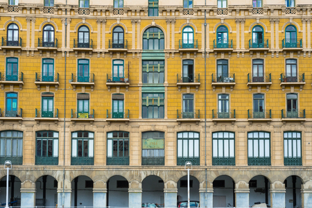 House facade in Bilbao at the Nervion river, that runs through the city. The apartment block is located in the San Frantzisko district of Bilbao. A colorful area with mixed population