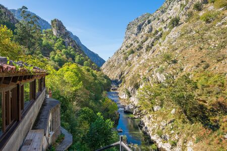 The mountain stream Rio Cares runs through the valley in the foothills of the National Park Picos de Europa. So the foothills are a popular hiking destination and leads along the Camino de Santiago