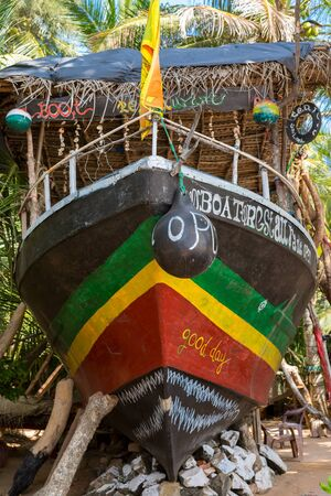Colorful restaurant ship in the garden of a tourist resort in Tangalle