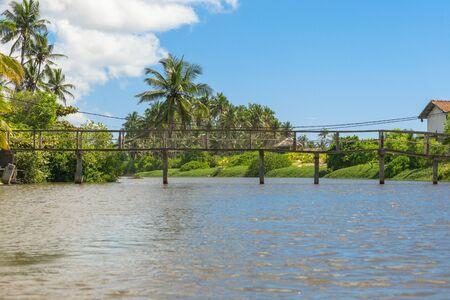 Bridge crossing the Rekawa lagoon, a scenic coastal lagoon in the south of Sri Lanka, situated in the east of the small town Tangalle. The lake has a big biodiversity with a variety of flora and fauna