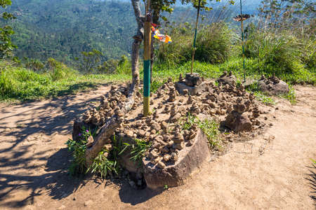 Stone garden with ceremonial cairn on the summit of the Little Adams Peak. The mountain is a main tourist attraction and easy to climb for hikers, tourists, locals and rambler