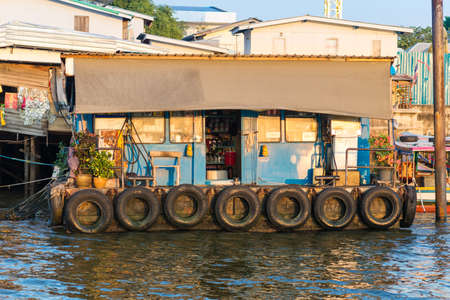 Filling station at the riverside of the Chao Phraya river in Bangkok. The station serves the long-tail boats, ferries and express boats as bunkering