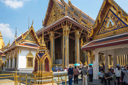 Tourists in the Wat Phra Kaew, commonly known in English as the Temple of the Emerald Buddha. The most sacred Buddhist temple in Thailand Editorial