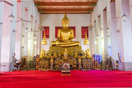 Large golden Buddha in lotus position in the Buddhist temple and monastery Wat Mahathat Yuwaratrangsarit. It is one of the 10 royal temples of the highest class in Bangkok