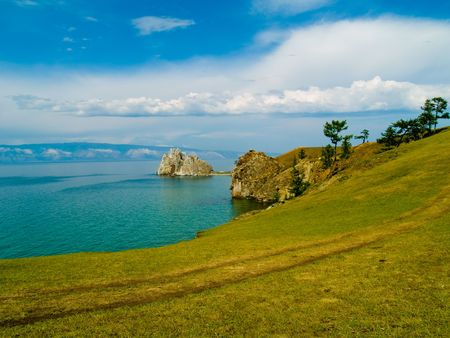 Russia, lake Baikal. A rock of Shamanka on cape Burhan. Island Olkhon. Stock Photo - 5342918