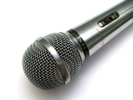 Silver vocla microphone with offon swither on white background photo
