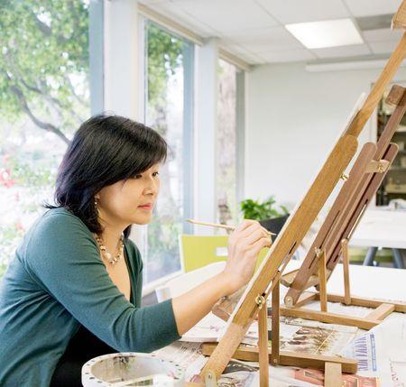 Art teacher in her classroom pianting