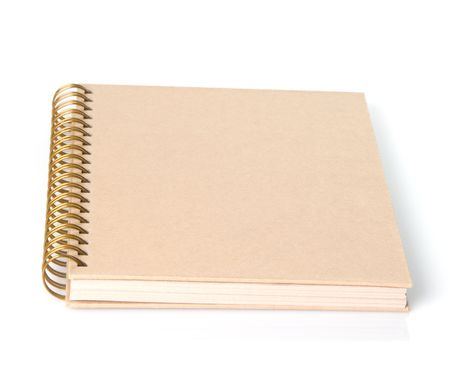 Blank spiral bound book covered in Kraft paper, shallow depth of field