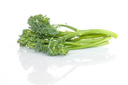 Fresh broccolini with reflection on white background Imagens