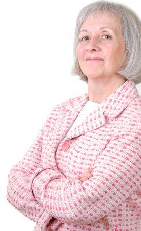 Senior businesswoman in pink jacket