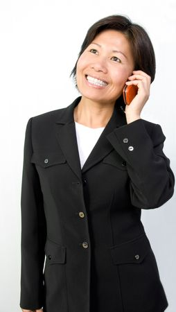 Pretty asian businesswoman talking on her cell phone. Stock Photo - 6415918