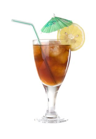 lemon wedge: Glass of iced tea with lemon wedge, green paper umbrella, and striped drinking straw