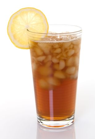 lemon wedge: Glass of iced tea with lemon wedge Stock Photo
