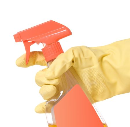 Hand wearing yellow latex glove and holding a spray bottle with cleaning fluid Imagens