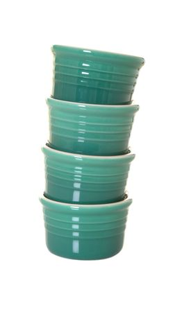 Stack of four green ramekins isolated