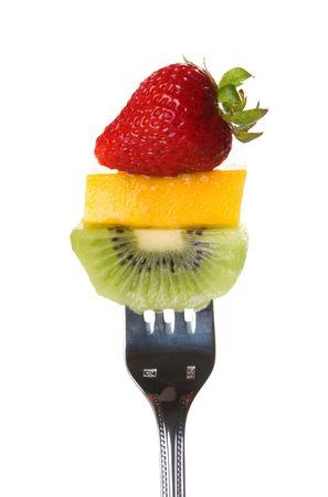 Fresh strawberry, mango slice, and kiwi on a fork 版權商用圖片